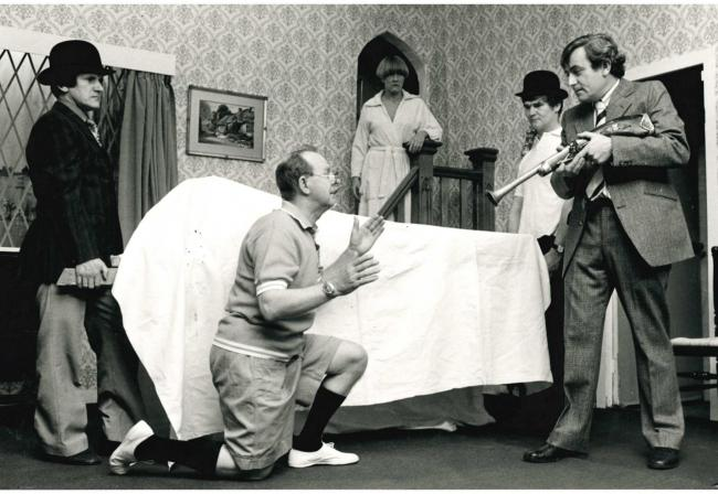 A scene from Love's a Luxury by Trinity Players, Farnworth in May 1980. Pictured from left Colin Higson, Fred Reeve, Jean Wood, Jim Webster and Norman Critchley