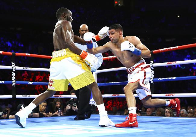 Amir Khan tries to go on the attack against Terence Crawford. Picture: Mikey Williams/Top Rank