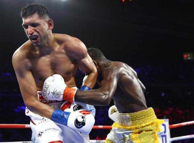 The Bolton News: Khan shows the pain inflicted by one of Crawford's precise blows