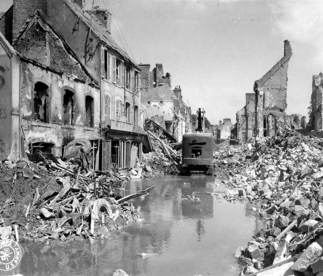 Undated handout photo of an Allied crane clearing rubble in a wrecked French village. See PA Feature NOSTALGIA D Day. Picture credit should read: James Holland/PA. WARNING: This picture must only be used to accompany PA Feature NOSTALGIA D Day.