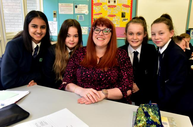 Jenny Ryan, star of The Chase at Westhoughton High School with pupils from left Zara Mohmed aged 12, Isabel Ingham aged 11, Lily Isherwood aged 11 and Macie Southern aged 11.