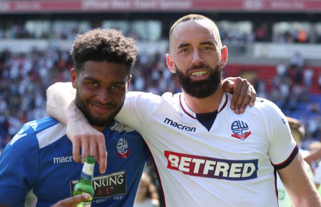 Mark Little, left, and Aaron Wilbraham celebrate keeping Wanderers up on the final day of the 2017/18 season
