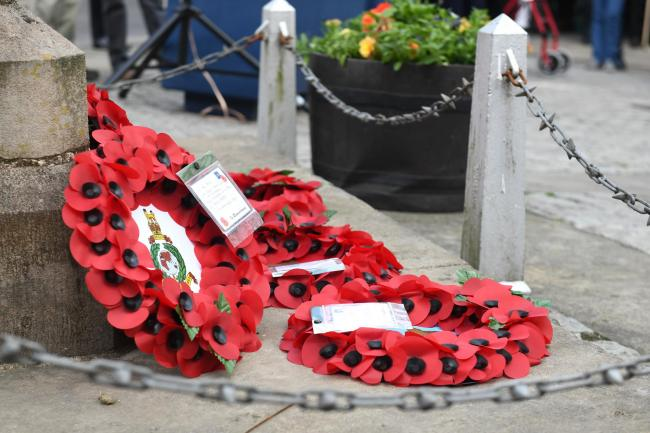 POPPIES: Wreaths laid at the war memorial.