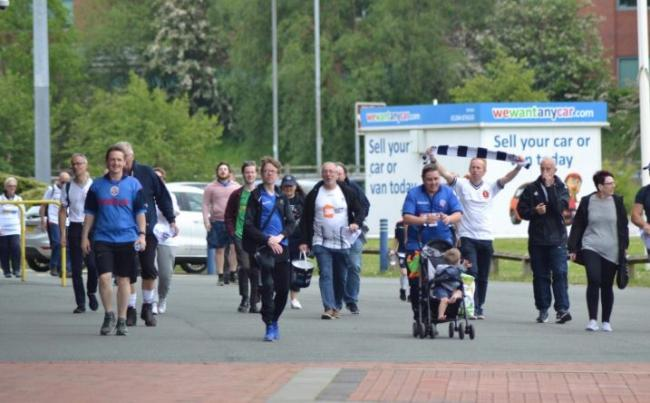 Fans complete their walk at the University of Bolton Stadium