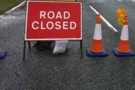 Traffic cones and a road closure sign