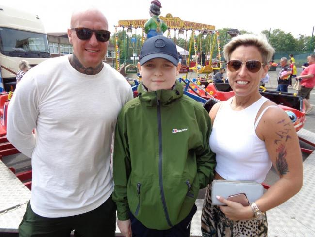 PROUD: Guest of honour Ethan with his mum and dad at last year's festival