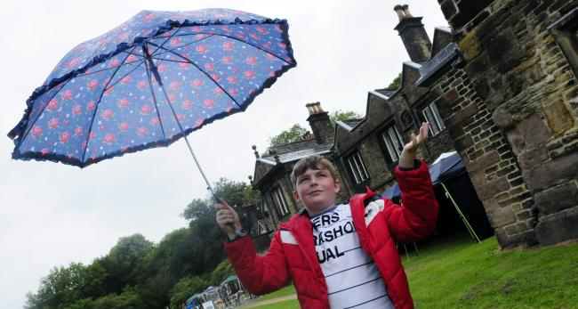 A CHANCE OF RAIN: Max Jamieson, then aged ten, stands with his umbrella at the 2015 edition of the garden party