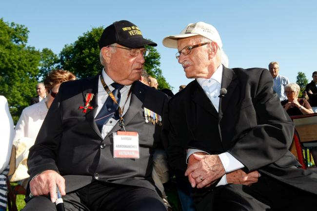World War II German veteran Kurt Keller, right, of Homburg, Germany, 89, who fought against the Allied landing on Omaha Beach on the 6 June 1944, speaks with World War II Dutch resistance and veteran Adriaan de Winter, 87, of Milsbeek, from the Netherland